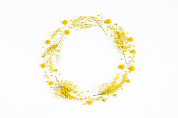 Flowers composition. Wreath made of yellow flowers on white background. Spring concept. Flat lay, top view