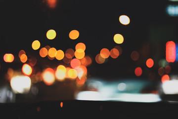 Fotomurales - traffic jam on night street, image blur urban road background