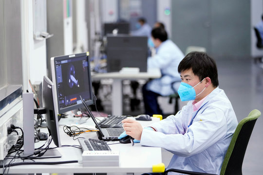 Employee wearing a face mask is seen at a workshop of computed tomography (CT) scanners of medical device firm Siemens Healthineers in Shanghai
