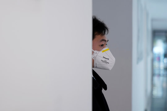 Security guard wearing face mask is seen at a workshop of computed tomography (CT) scanners of medical device firm Siemens Healthineers in Shanghai