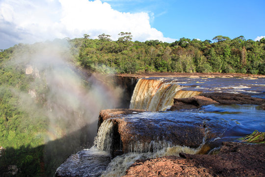 View of The beautiful powerful Kaieteur waterfall on a clear Sunny day against the background of the jungle, the height of the waterfall is 221 meters, Guyana. World tourism, adventure, ecotourism.