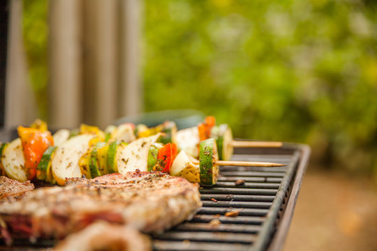 Grilling meat outdoors during a weekend rest