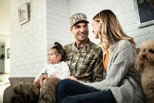 Happy military family reuniting at home.