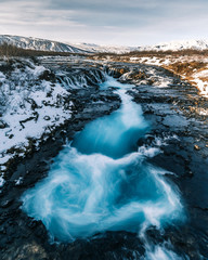 Bruarfoss Waterfall in winter. Beautiful landscape of breathtaking Iceland that is worth it to visit all year long. Tourism in Iceland has its boom because of the unforgettable gorgeous scenery