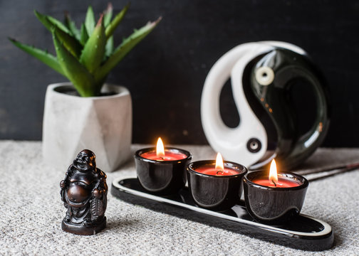 Composition with Buddhist symbols: yin yang, turtles, elephants, aroma candles, rosaries and bells. feng shui and zen concept