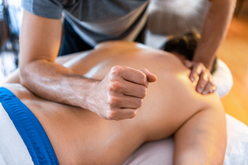 Sports massage therapy in the medical clinic. Therapeutic body massage treatment. Sports injury rehabilitation concepts.