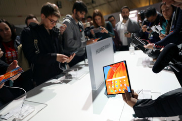 People take pictures of Huawei Mate Xs foldable smartphones during Huawei products launch event in Barcelona