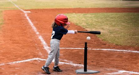 Baseball kid up at bat making a hit