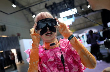Woman wears VR glasses during Huawei product launch event in Barcelona