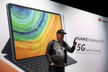 A man holds a small camera during Huawei product launch event in Barcelona