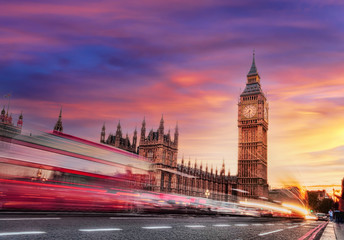 Fototapete - Big Ben with red bus against colorful sunset in London, England, UK