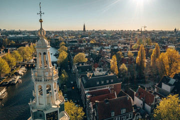 Wall Mural - Amsterdam skyline in historical area, Amsterdam, Netherlands. Ariel view of Amsterdam. Landscape and nature travel, or historical building and sightseeing concept.