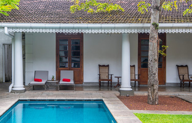 swimming pool in the court yard of a colonial style boutique hotel