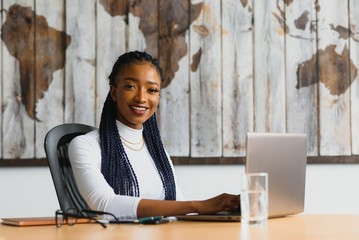 successful african american business woman in modern office