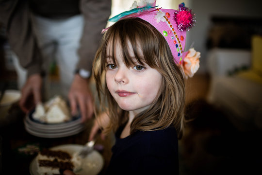 five year old girl with pink birthday crown