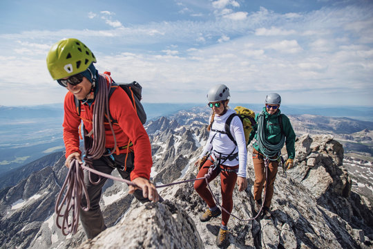 Climbing guide leads two clients to the summit of the Grand Teton