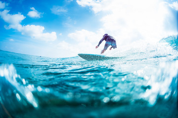 Wall Mural - Surfer rides the ocean wave on Sultans surf spot in Maldives