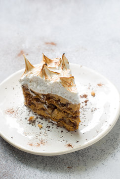 Slice of walnuts and merengue cake close up