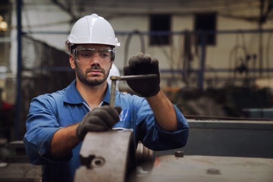 Engineers and skilled technicians are maintaining machinery. Technicians and engineers are working and repairing machines in industrial plants.