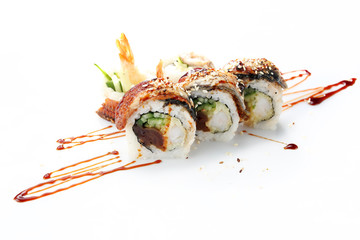 Photo sur Aluminium Sushi bar Uramaki sushi with tuna, shrimp, cucumber and gourd. Traditional sushi rolls on a white background.