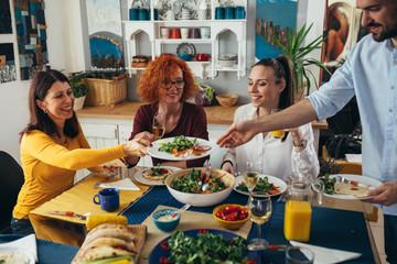 Foto op Canvas Kruidenierswinkel family gathering at home. vegan dinner party