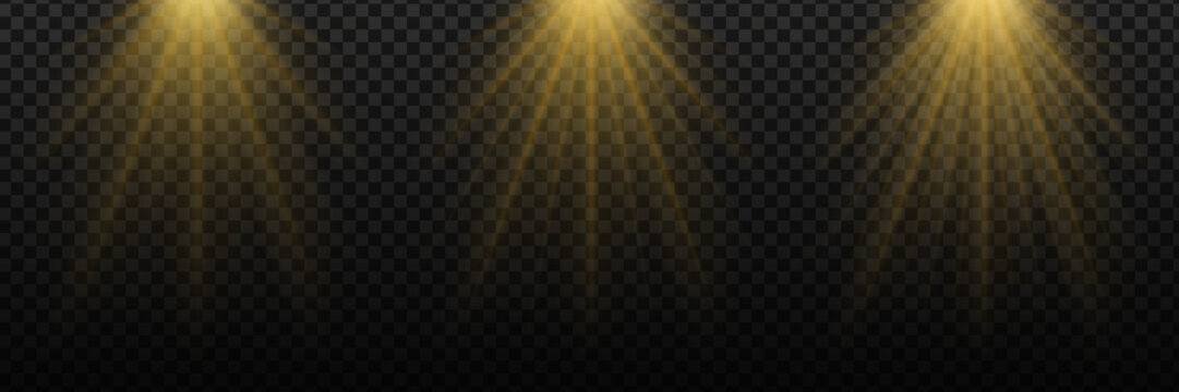The rays of the sun or light, vector set. Different brightness. Golden light from a searchlight, lighting a scene. EPS 10