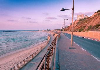 Fototapete - Descent to Sironit Beach in the city of Netanya at sunset. Promenade along the sea. Israel