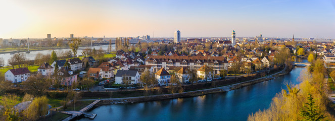 Beautiful aerial view of Kehl cityscape on evening with the Rhine river on the left, border between Germany and France, from the Weißtannenturm.