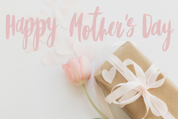 Happy mother's day.  Happy mother's day text and pink tulips with gift box on white background....