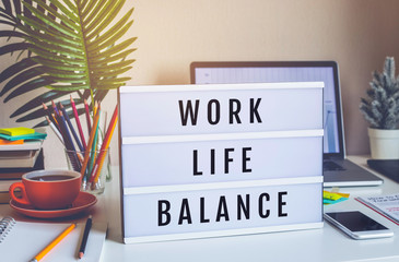 Work Life Balance concepts with text on light box on desk table in home office.positive emotion to success