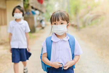 New Normal after COVID-19 outbreak,Little school girl has mask protect herself from Coronavirus when go to school,Student with a mask on her nose for safety outdoor activity,illness or Air pollution
