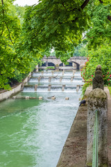 Fototapete - Majestic river in Park in Munich, Germany.