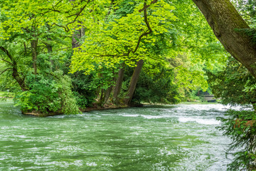 Wall Mural - Majestic river in Park in Munich, Germany.