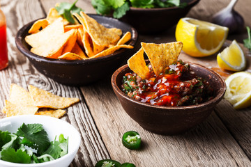 Homemade salsa and tortilla chips, favorite Mexican appetizer snack