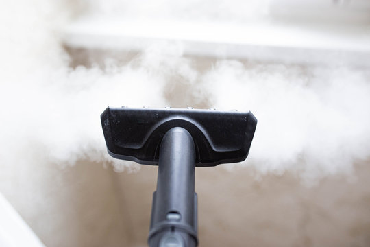 steam cleaner for cleaning the house, steam erupts from the brush.