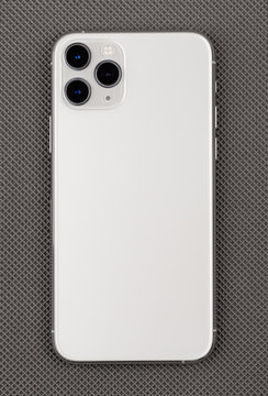 Smartphone on a gray surface. A popular smartphone close-up.