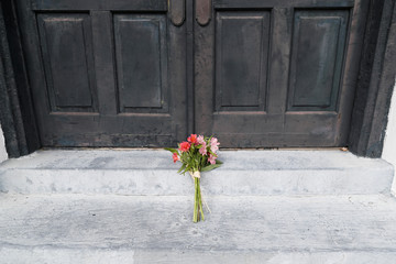 Fresh cut flowers lay below the door of the Emanuel African Methodist Episcopal Church, site of a 2015 mass shooting, before the start of the tenth U.S. Democratic presidential candidates debate in Charleston