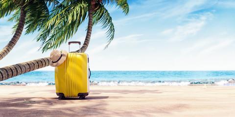 Fototapeta Yellow suitcase under palm tree on sunny beach, travel background 3D Rendering obraz