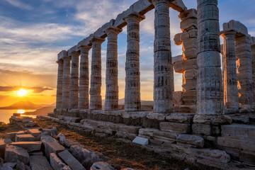 Fototapeten Kultstatte Poseidon temple ruins on Cape Sounio on sunset, Greece
