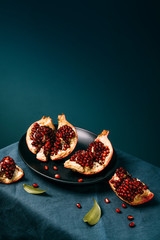 Fresh ripe pomegranate open on plate