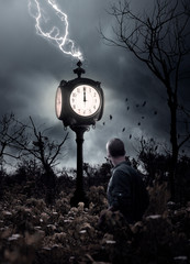 Man in forest looks at clock at midnight, conceptual image