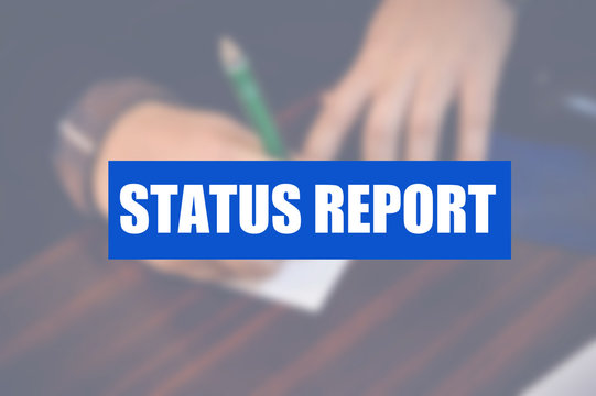 Status report word with business blurring background