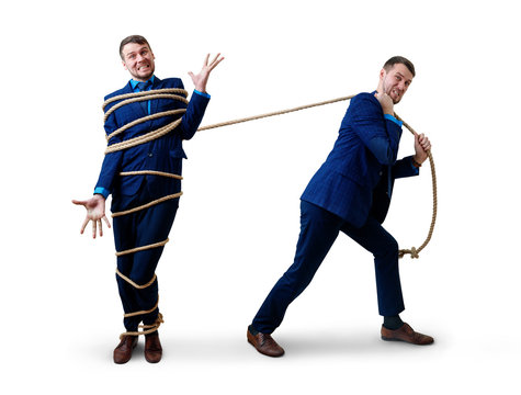 Angry businessman pulls tied himself with a rope.