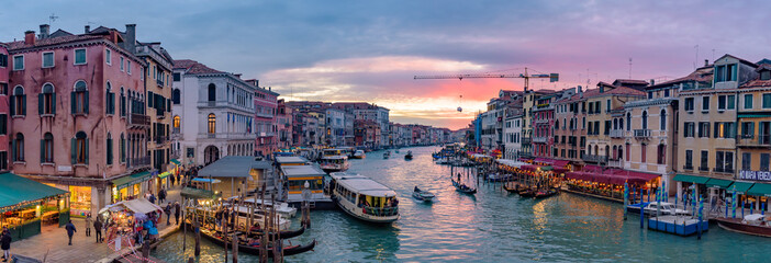 Keuken foto achterwand Gondolas The Grand Canal with gondola and vaporetto at sunset time, Venice, Italy