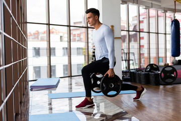 Side view of man doing lunges
