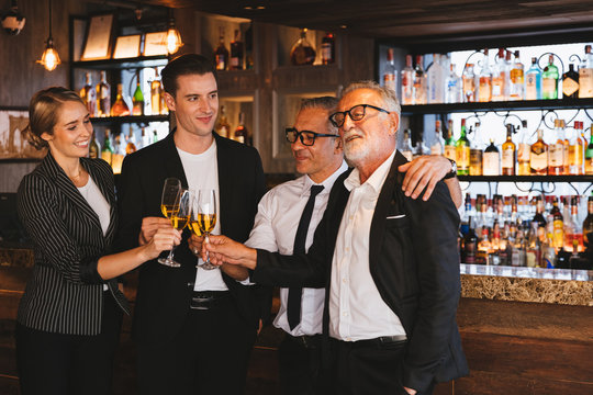 Multiethnic group businesspeople holding aperitif champagne, Business people party celebration success after meeting. Business and celebration concept.