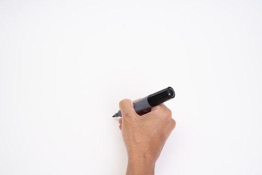 Man hand holding black magic marker pen writing on white background