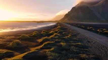 Wall Mural - Flying over a dirt road at sunset with Vestrahorn mountain in Iceland