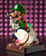 Moscow, Russia - February 25, 2020: Luigi and Ghost Polterpup figurine on pink background
