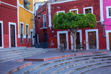 Colored colonial houses in old town of Guanajuato. Colorful alleys and narrow streets in Guanajuato city, Mexico. Spanish Colonial Style.